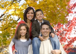 Family portrait with autumn colors and trees